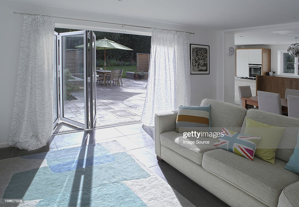 Open plan living area with open patio doors
