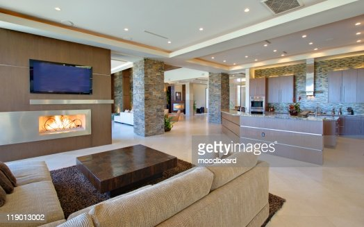 Open planned interior with furniture, a television and a kitchen : Foto de stock