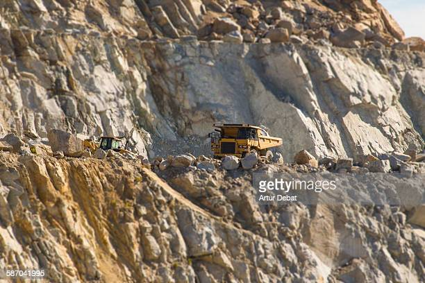 Open quarry factory with heavy machines.