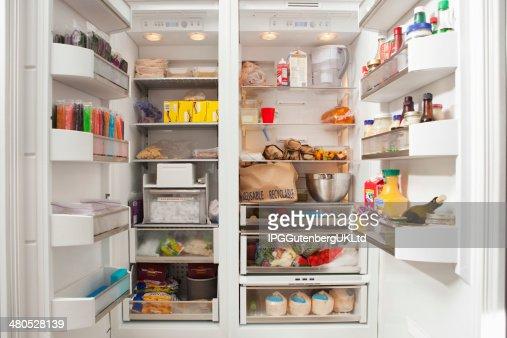 Open Refrigerator With Stocked Food Products : Bildbanksbilder