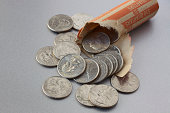 Open roll of US quarter dollar coins on steel surface