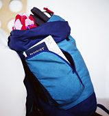 Open rucksack with belongings showing, side view