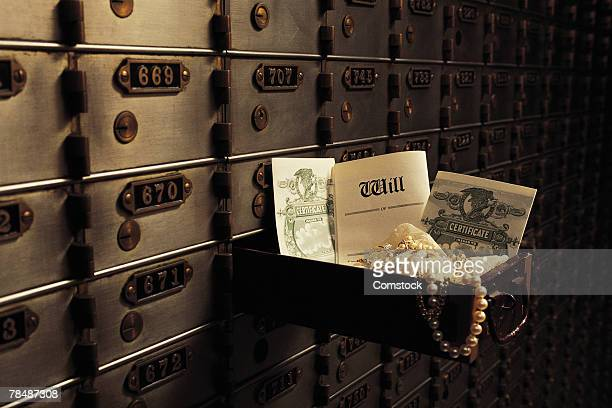 Open safe deposit box in bank vault