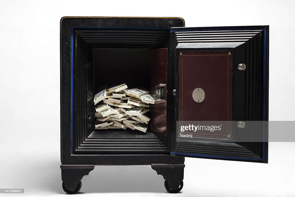 Open safe with stacks of cash