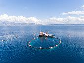 Drone photo of a open sea fish farm in the Mediterranean Sea.