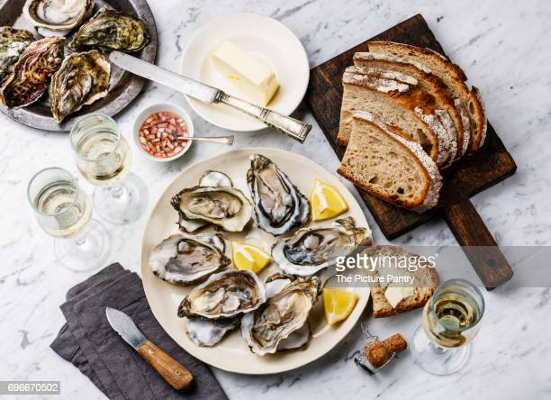 Open shucked oysters with bread, butter and champagne