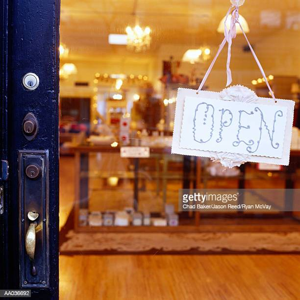 Open sign hanging on store door