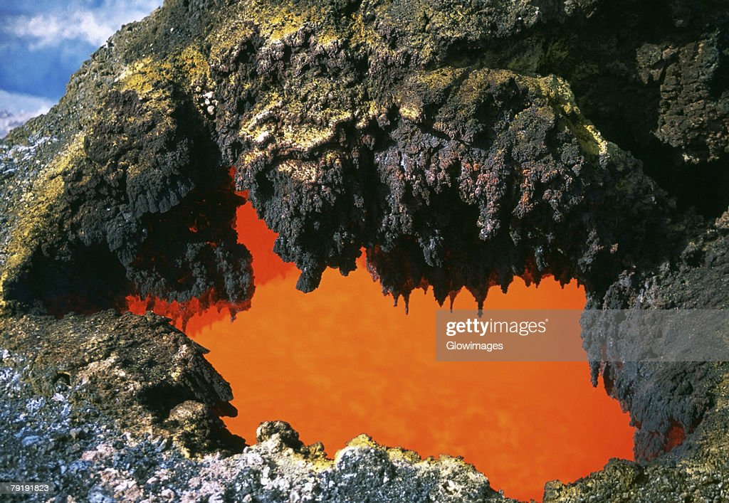 Open 'skylight' reveals river of molten lava flow, Hawaii : Stock Photo