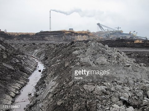 open Strip Coal mine with smoke stake fumes
