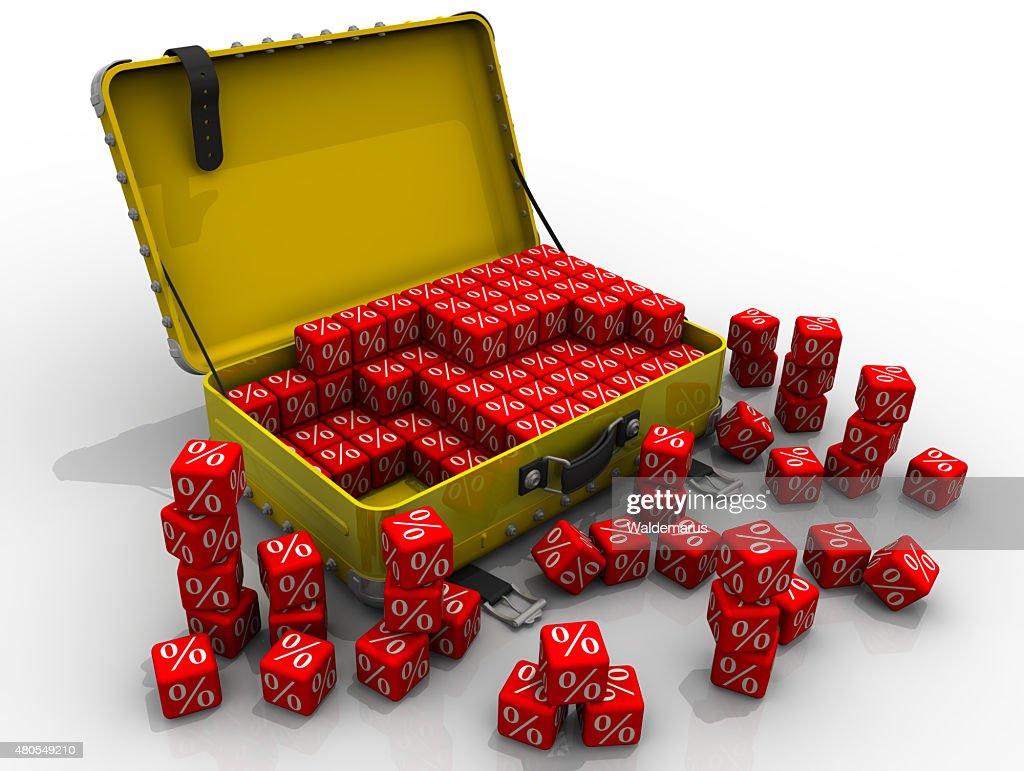 Abra a mala e cubos com um símbolo de percentagem : Foto de stock