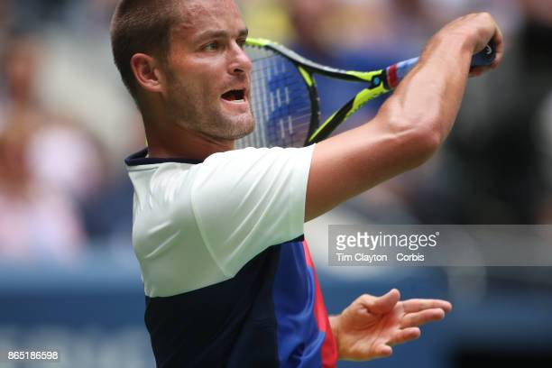S Open Tennis Tournament DAY FOUR Mikhail Youzhny of Russia in action against Roger Federer of Switzerland during the Men's Singles round two match...