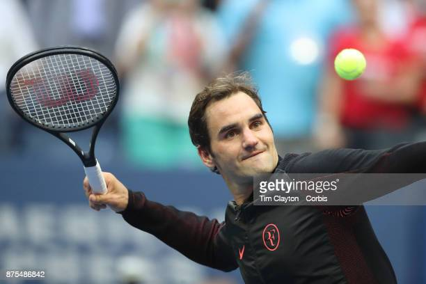 S Open Tennis Tournament DAY FOUR Roger Federer of Switzerland hits balls into the crowd after his victory against Mikhail Youzhny of Russia during...