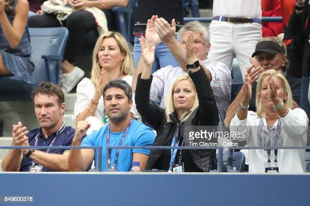 S Open Tennis Tournament DAY TEN Pat Cash coach of CoCo Vandeweghe of the United States watches her in action with family member from the family box...