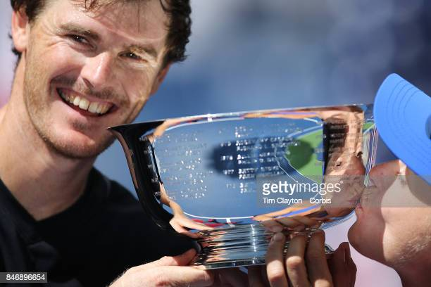 S Open Tennis Tournament DAY THIRTEEN Martina Hingis of Switzerland and Jamie Murray of Great Britain with the winners trophy after winning the Mixed...