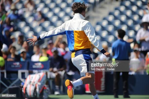 S Open Tennis Tournament DAY THREE Dominic Thiem of Austria kicks balls into the crowd after his victory against Alex de Minaurof Australia during...