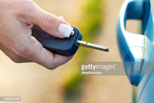 open the car - woman hand with car key