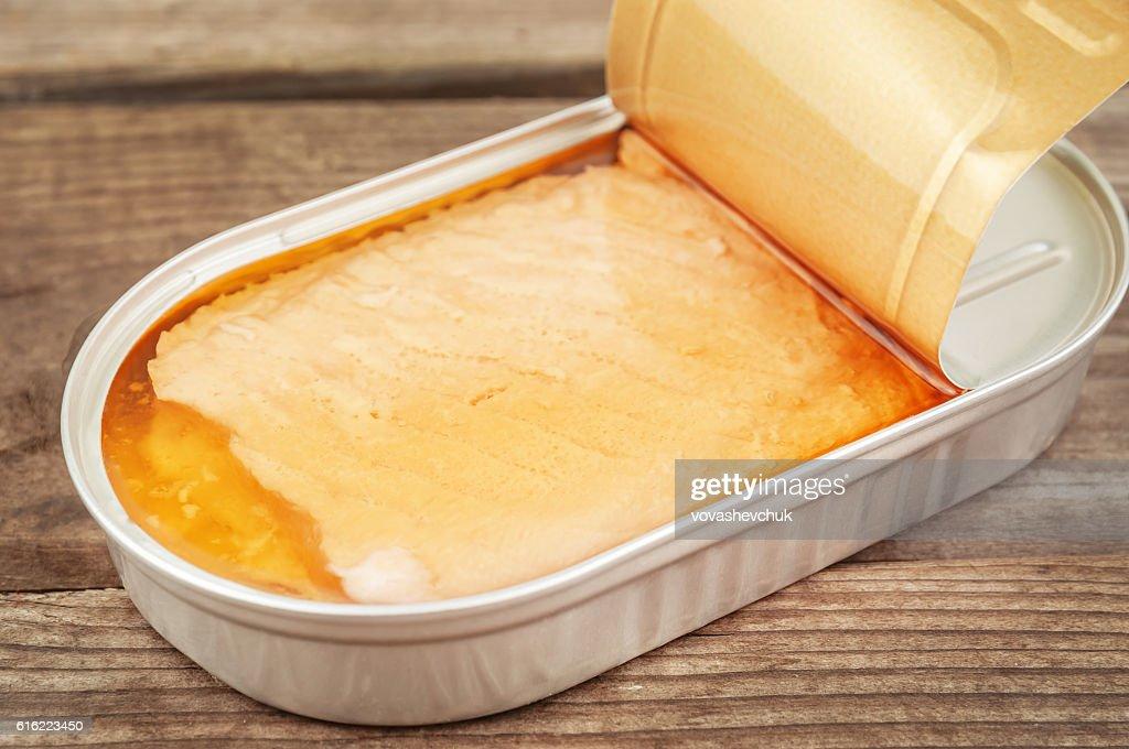 open tin with salmon : Stock Photo