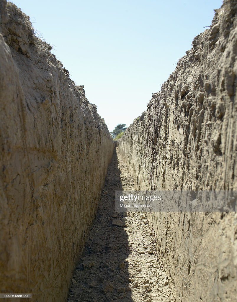 Open trench, low angle view : Stock Photo