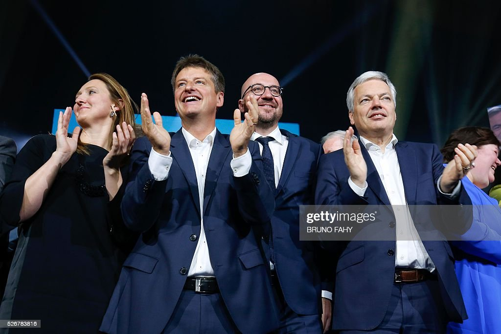 Open Vld chairperson Gwendolyn Rutten, French-speaking liberal Reformist Movement (MR) chairperson Olivier Chastel, Belgian Prime Minister Charles Michel and Vice-Prime Minister and Foreign Minister Didier Reynders attend an MR May Day meeting in Jodoigne on May 1, 2016. / AFP / Belga / BRUNO FAHY / Belgium OUT