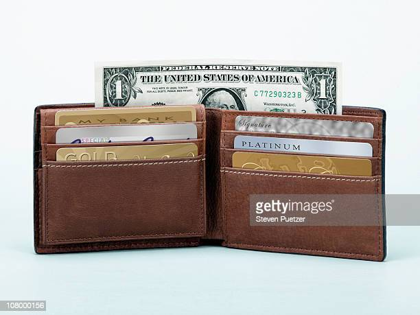 Open wallet with credit cards and one dollar bill