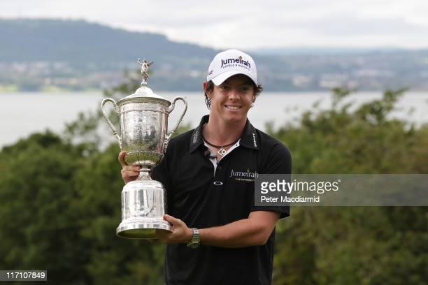 Open winning golfer Rory McIlroy poses with his trophy on a green at Holywood Golf Club on June 22 2011 in Belfast Northern Ireland The 22 year old...