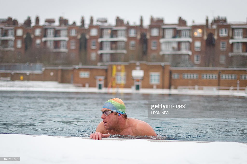 Open-air swimming enthusiast John Donald braves the icy temperatures to swim his sixth mile in six days at a lido in north London on January 19, 2013. While some people are savouring the cold conditions, snow that swept across Britain on January 18 continues to cause travel difficulties across the country.