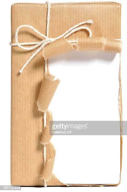 Opened, brown wrapped parcel