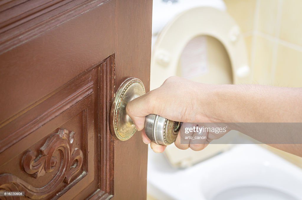 Opened door with toilet room : Stockfoto