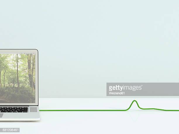 Opened laptop with green cable, 3D Rendering