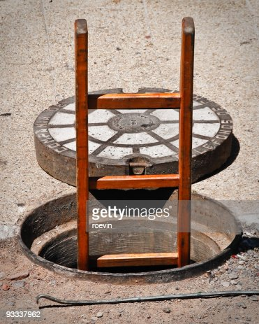 Opened Manhole : Stock Photo