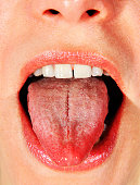 opened mouth of woman with put her tongue out