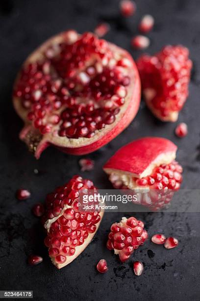 Opened pomegranate and arils
