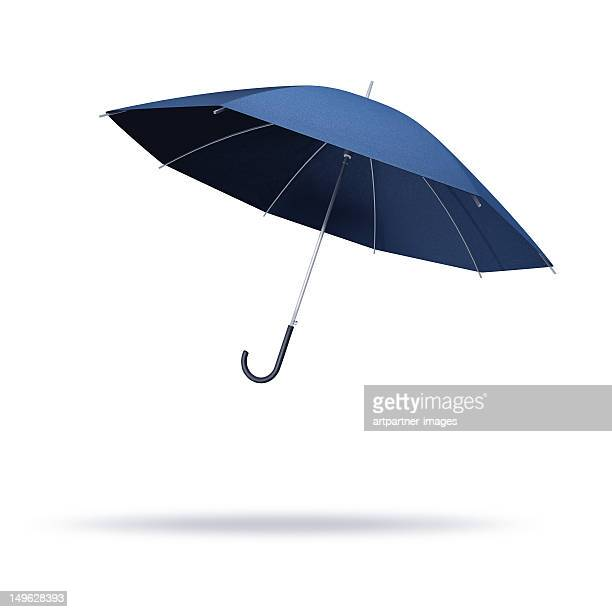 Opened umbrella floating on a white background