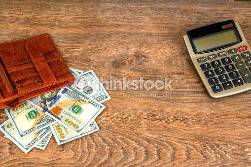 Precio 50% seleccione para el despacho diseñador nuevo y usado Abrir Cartera Con Billetes De Dólar Y Calculadora En La ...