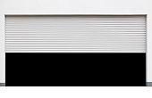 Opened white shutter door isolated on white background