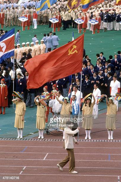 1980 Summer Olympics USSR flag bearer and wrestler Nikolay Balboshin during parade of nations at Central Lenin Stadium Moscow Soviet Union 7/19/1980...