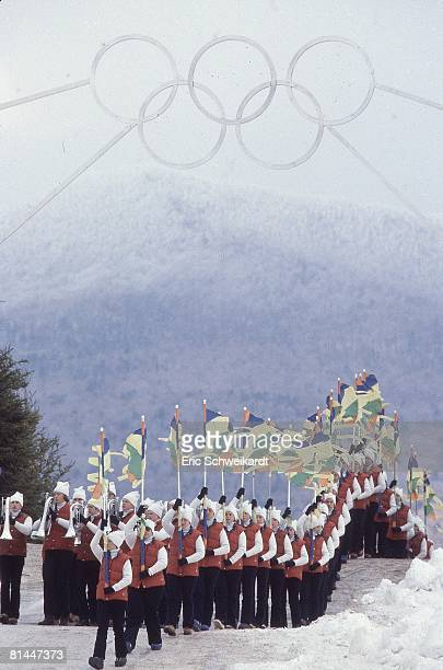 Opening Ceremony 1980 Winter Olympics Scenic view of marching band with flags Lake Placid NY 2/13/1980