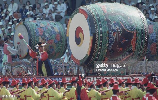 Opening Ceremony 1988 Summer Olympics Korean beating large dragon drums during ceremonies Seoul KOR 9/17/1988