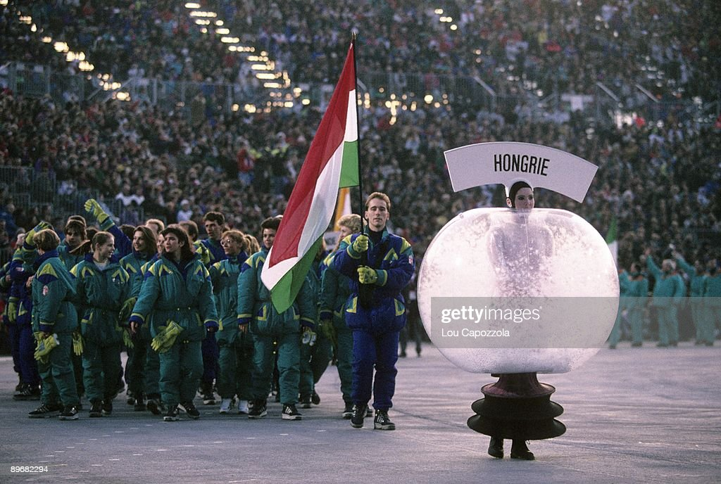 1992 Winter Olympics Team Hungary flag bearer Attila Toth leading delegation during athlete procession at Theatre des Ceremonies Albertville France...
