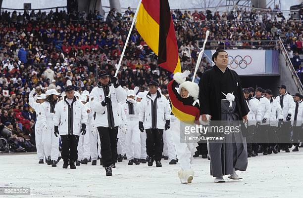 1998 Winter Olympics Team Germany flag bearer Jochen Behle leading delegation during athlete procession at Olympic Stadium Nagano Japan 2/7/1998...