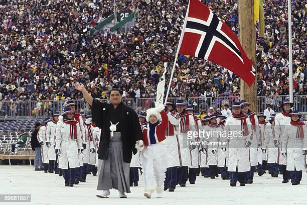 1998 Winter Olympics Team Norway with flag bearer Espen Bredesen leading delegation during athlete procession at Olympic Stadium Nagano Japan...