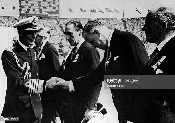 Opening ceremony in the London Wembley stadium King George VI welcoming the members of the Olympic Committee shaking hands with IOC president...