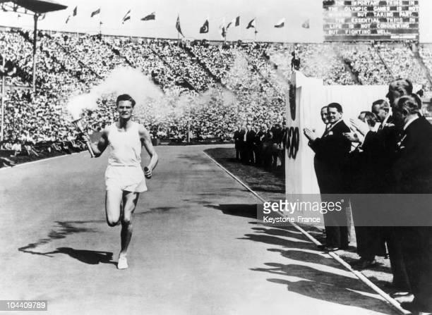 Opening ceremony of the Summer Olympics at Wembley Stadium The last torch bearer John MARK running in front of the VIP stand to the applause of the...