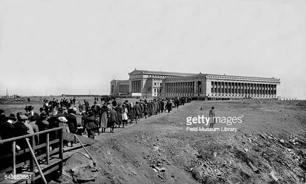 Opening Day for the Field Museum in Grant Park shows a long line of people and crowds approaching the museum via a wooden bridge Chicago Illinois May...