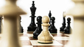 pawns standing face to face