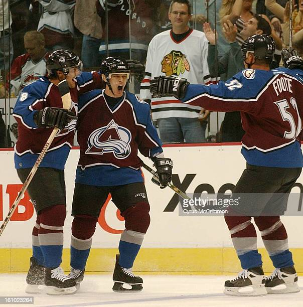 BLACKHAWKS Opening game of the hockey season at the Pepsi Center In the first period Avalanche teammates Teemu Selanne and Adam Foote celebrate Paul...