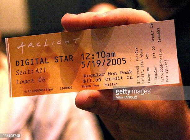 Opening Night of Star Wars Episode III Revenge of the Sith in Hollywood United States on May 19 2005 A Star Wars moviegoer holds up his ticket on the...