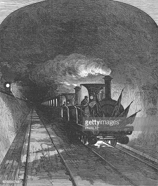 Opening of the Mont Cenis railway tunnel linking France and Switzerland Work begun 1857  Inauguration train passing through Septemebr 1871Wood...