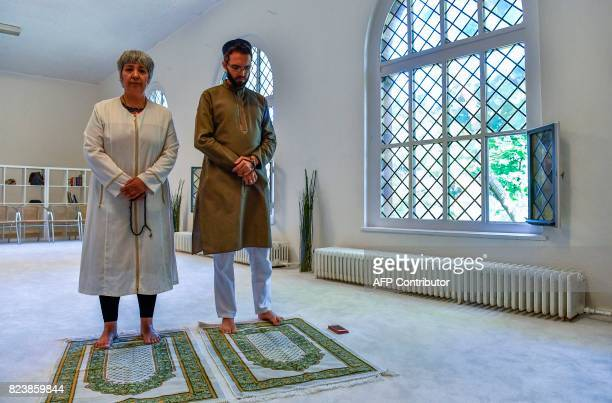 Openly gay French imam LudovicMohamed Zahed and GermanTurkish lawyer author and activist Seyran Ates pose for photographers prior to Friday prayers...