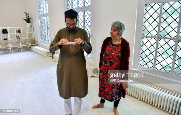Openly gay French imam LudovicMohamed Zahed and GermanTurkish lawyer author and activist Seyran Ates use a smartphone app to establish the Qibla or...